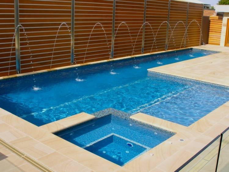 I like how the hot tub is embedded in the swimming pool