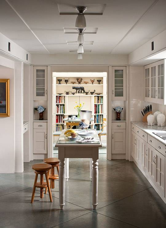 Two light bars under white cabinets in a transitional, elegant kitchen  setup