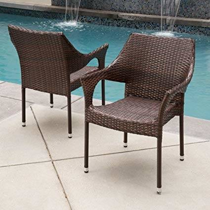 A patio conversation set with a wicker coffee table