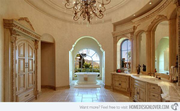 Mediterranean master bathroom with tray ceiling, chandelier, freestanding  tub and tile flooring
