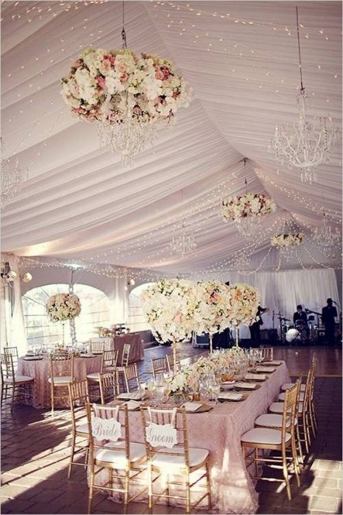 Hanging wedding decor is really having a moment, and it doesn't get much  more classic than an ornate chandelier