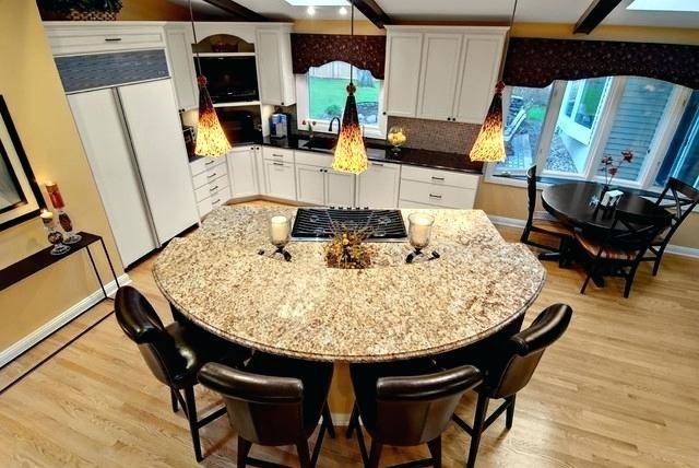 View in gallery Rectangular kitchen island with a round table and  colorful chairs View in gallery Small