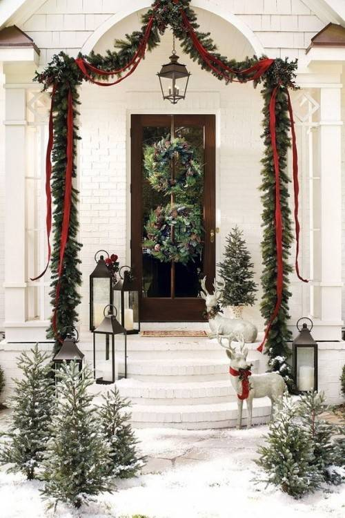 Decorate your front porch with rope  garland, red ribbon