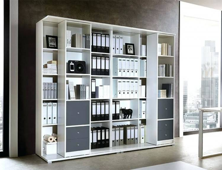 A bookshelf, file storage, and wall pockets turn a small sliver of wall  into a hardworking storage system