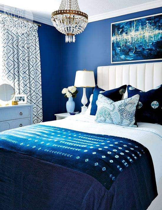 Place mirrors on your nightstands' drawers for a unique look that will  brighten up your blue bedroom