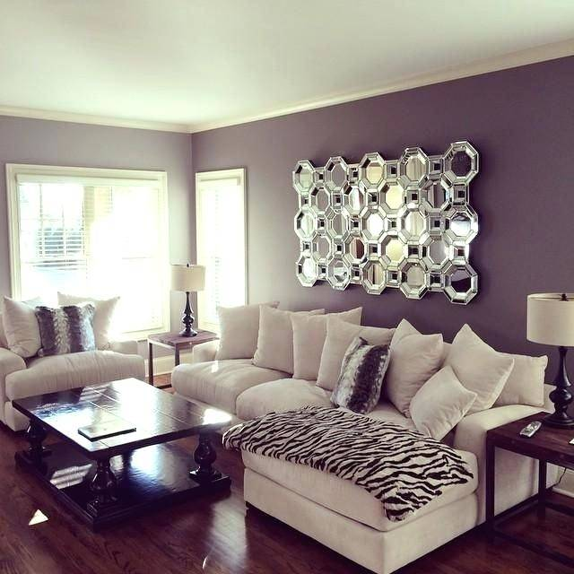 View in gallery Modern living area design with purple chairs and grey