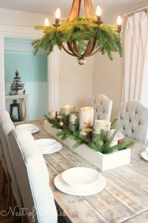 Dining room with tabletop tree and evergreen swags