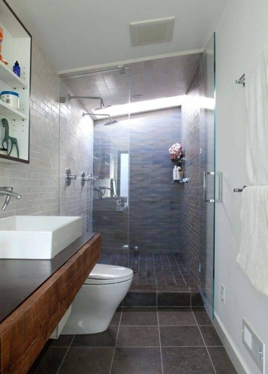 Narrow bathroom benefits from shower window to break up the space and  provide fresh air