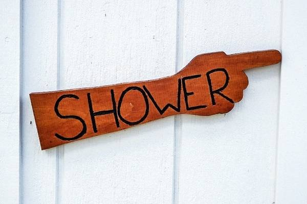 Outdoor pool shower with pool rules sign in Swanley
