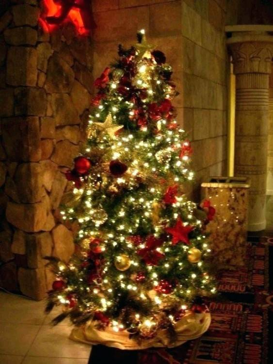 white tree with retro ornaments and  lights