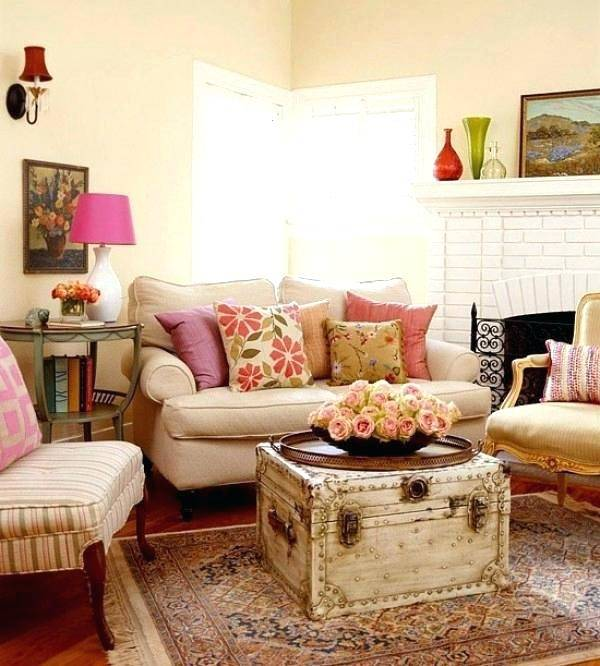 Use natural materials to decorate a rustic country living room, such as  bundled sticks, chopped wood, and fresh (or silk) plants