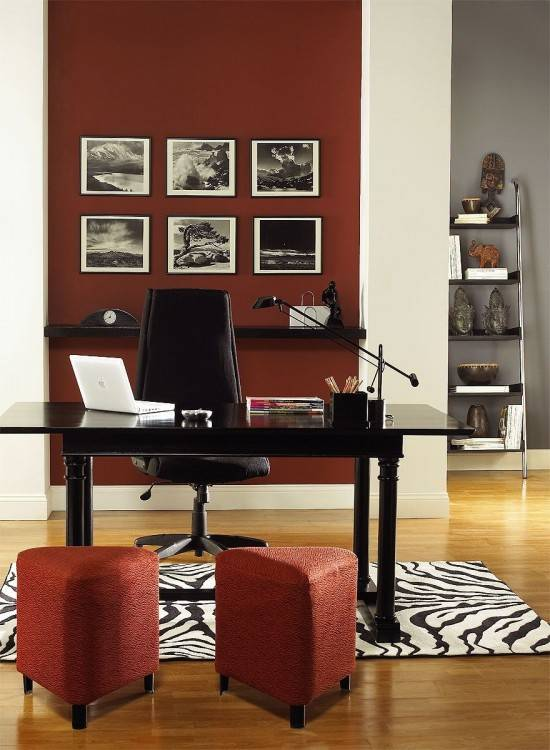 Eclectic home office uses plush leather chairs to bring in a dash of red  [From