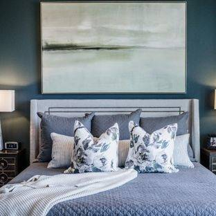 The bedframe is black with a blue comforter