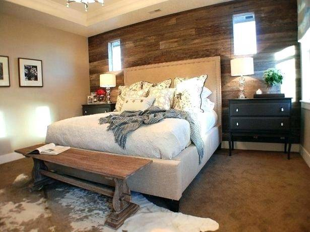 Farmhouse bedroom with vaulted ceiling, barn doors and whitewashed shiplap  accent wall