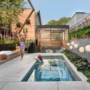Nature encompasses the home's pool, spa, and patio outfitted with a summer  kitchen