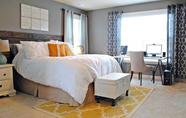 You can see from this picture that a simple small area rug can make a huge  statement in such an elegant bedroom