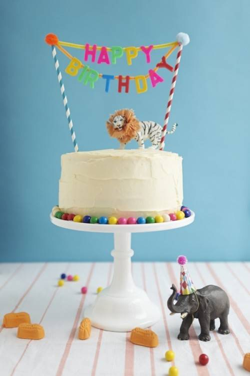 I love this idea for your child's birthday – simply cover the cake in their  favorite candies! And if you want a cute cake stand, check out this one