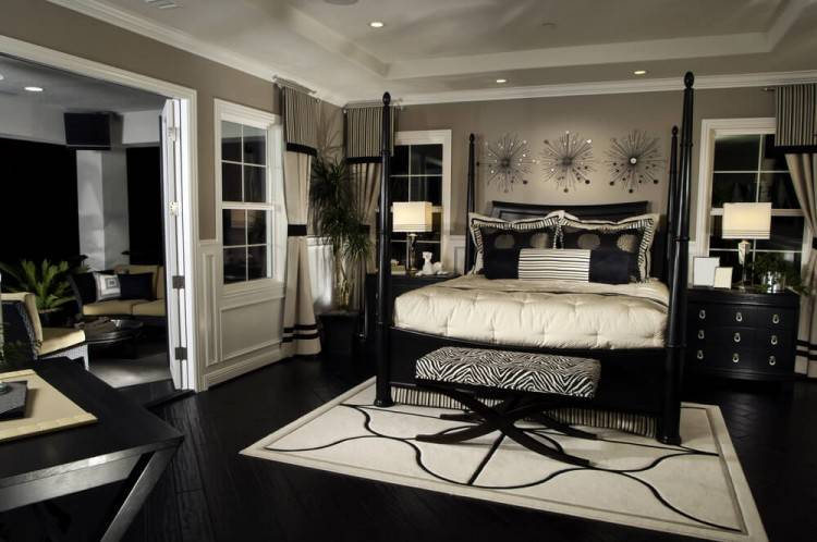 A beautiful contemporary master bedroom with fireplace, balcony and lovely  reading nook corner