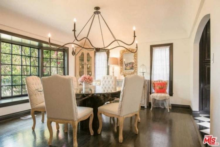 Eclectic red dining room with chandelier and rectangular wooden table