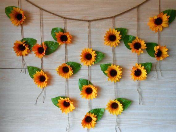 simple summer wedding centerpiece with sunflower in mason jar on woodcut table  centerpieces sunflowers decorating tables