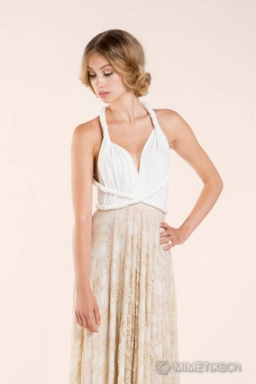 Sheer bateau neckline and  low open back
