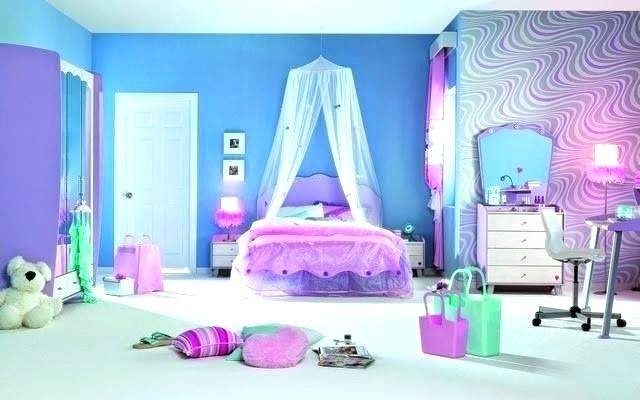 We love how the blue hanging chandelier, rocking chair and dresser all  perfectly match in this preteen girls bedroom
