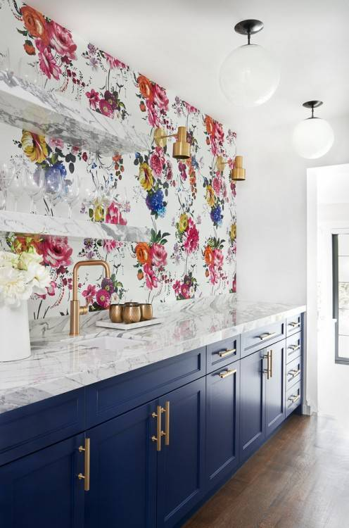 Hang wallpaper above the cabinets that will completely transform the room