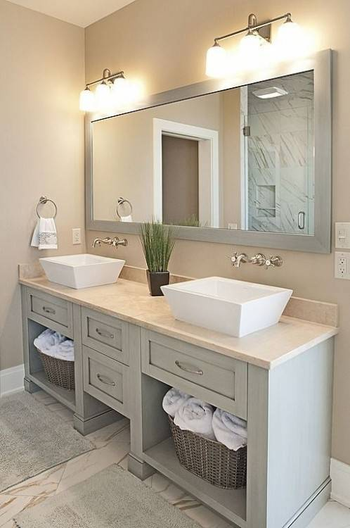 In movie producer Avi Arad's Malibu, California, house, which was designed  and decorated by Richard Hallberg and Barbara Wiseley, the master bath's  mirrors,