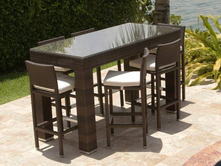 This set includes: 2 swivel chairs, 4 arm chairs, and a glass top table