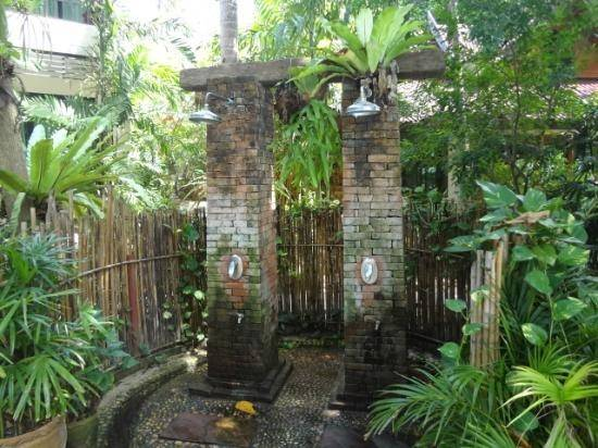 exotic tropical outdoor bathroom with shower and bathtub
